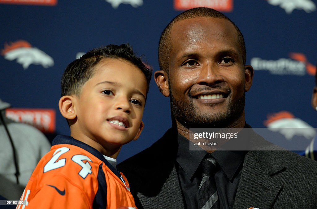 Denver Broncos <a gi-track='captionPersonalityLinkClicked' href=/galleries/search?phrase=Champ+Bailey&family=editorial&specificpeople=213482 ng-click='$event.stopPropagation()'>Champ Bailey</a> and his son Brayden smile for the cameras after his press conference to announcing his retirement as a Denver Bronco November 18, 2014 at Dove Valley.