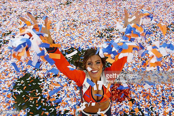 Denver Broncos cheerleader celebrates after they defeated the New England Patriots 26 to 16 during the AFC Championship game at Sports Authority...