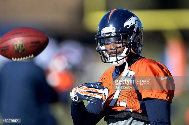 Denver Broncos cornerback Champ Bailey flips the football during drills at practice November 27 2013 at Dove Valley
