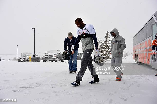 Denver Broncos cornerback Champ Bailey heads to the bubble for practice November 4 2013 at Dove Valley