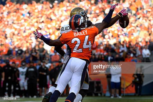 Denver Broncos cornerback Champ Bailey knocks away a pass to Jacksonville Jaguars wide receiver Justin Blackmon late in the 4th quarter at Sports...