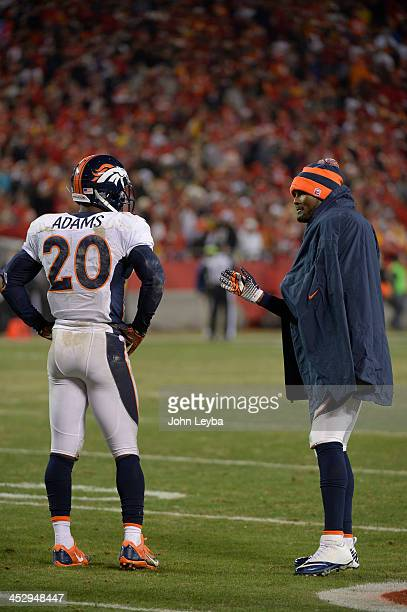 Denver Broncos cornerback Champ Bailey talks with Denver Broncos strong safety Mike Adams during a timeout late in the fourth quarter with Kansas...