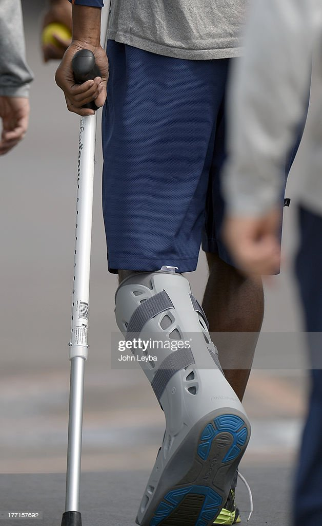 Denver Broncos cornerback Champ Bailey walks to his rehab session during practice August 22, 2013 at Dove Valley. Bailey was wearing a walking boot cast and crutches.