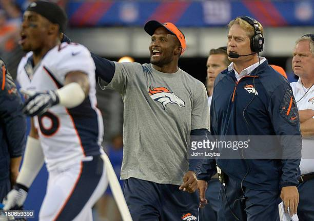 Denver Broncos cornerback Champ Bailey yells out at the defense as defensive coordinator Jack Del Rio looks on during the third quarter September 15...