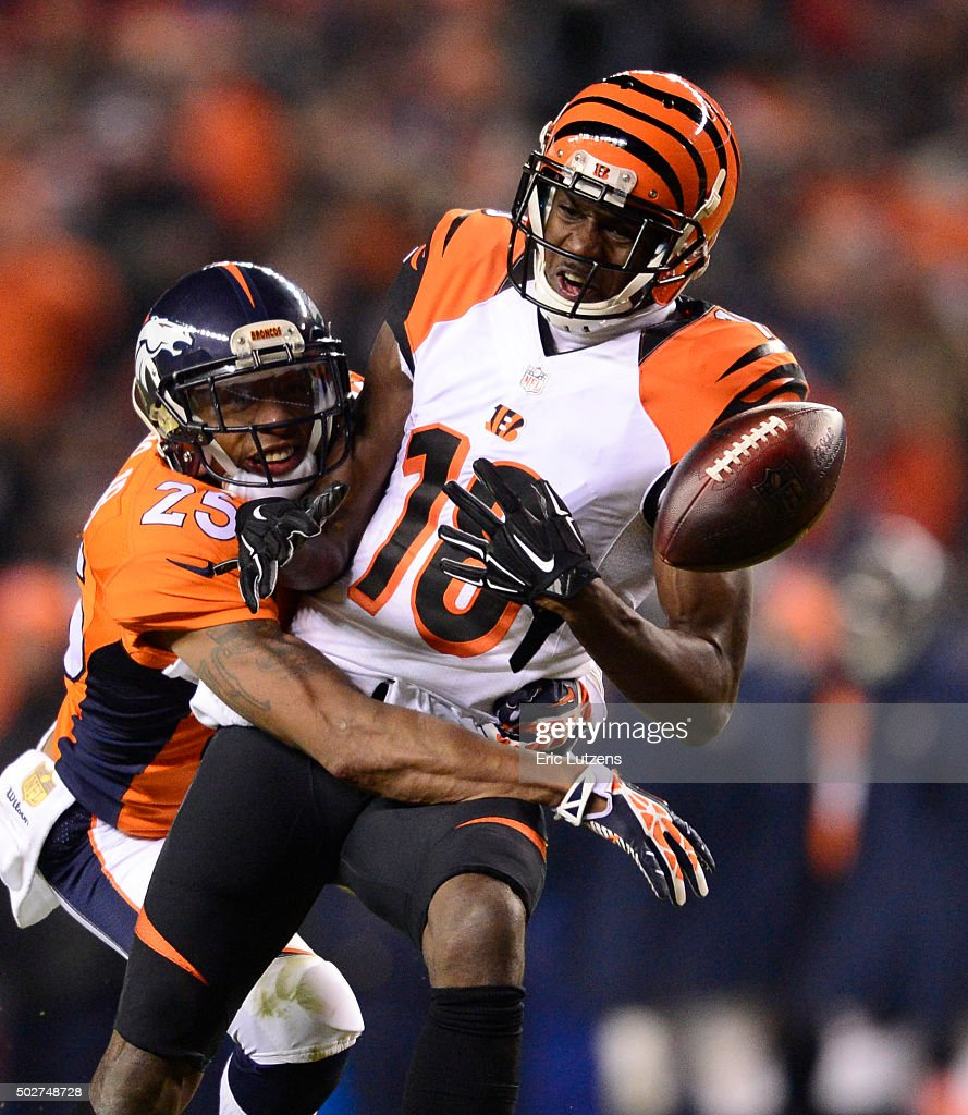 Denver Broncos cornerback <a gi-track='captionPersonalityLinkClicked' href=/galleries/search?phrase=Chris+Harris+-+American+Football+Cornerback&family=editorial&specificpeople=15029474 ng-click='$event.stopPropagation()'>Chris Harris</a> (25) knocks a pass away intended for Cincinnati Bengals wide receiver <a gi-track='captionPersonalityLinkClicked' href=/galleries/search?phrase=A.J.+Green&family=editorial&specificpeople=5525868 ng-click='$event.stopPropagation()'>A.J. Green</a> (18) during the fourth quarter December 28, 2015 at Sports Authority Field at Mile High Stadium.