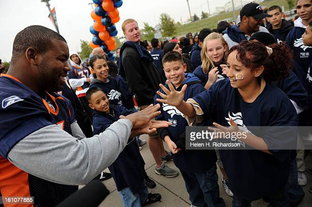 Denver Broncos Daryl Hackney left tries to beat Jocelyne Raygoza 12 at a game of Rock Scissors Paper or Ro Sham Bo In celebration of fitness children...