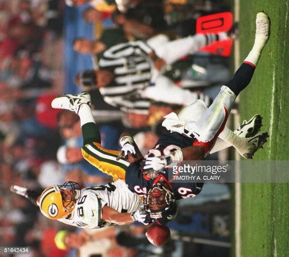 Denver Broncos Defender Ray Crockett (bottom) Brea