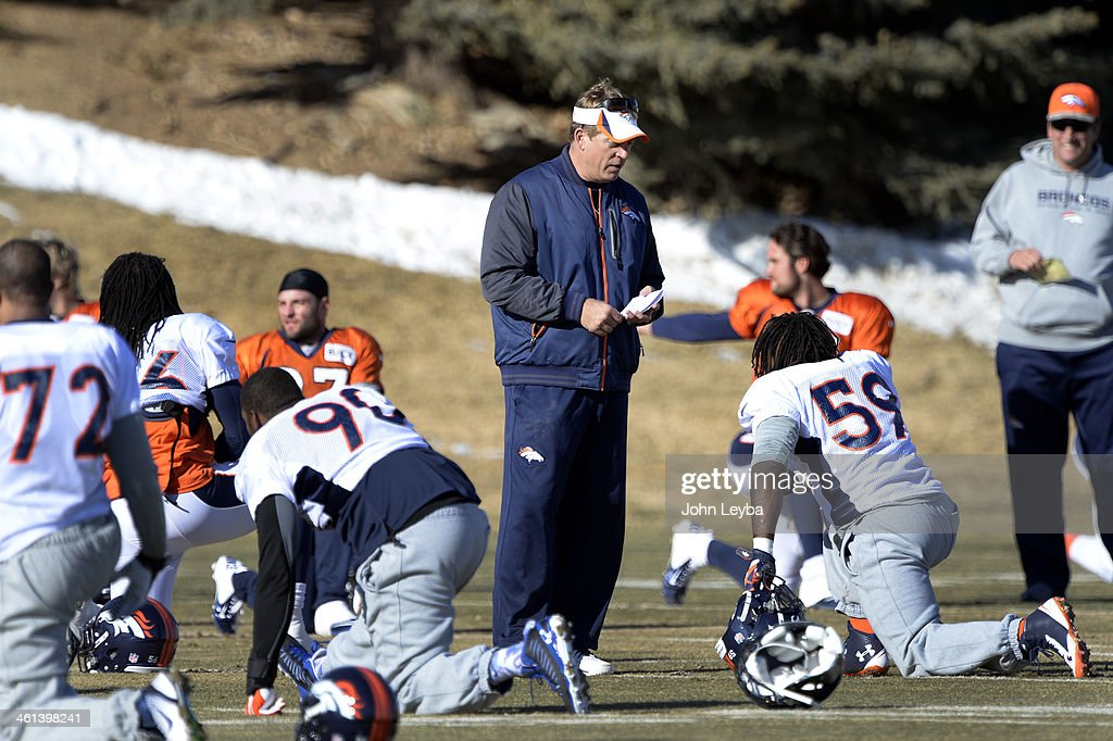 Denver Broncos defensive coordinator Jack Del Rio talks with Denver Broncos outside linebacker Danny Trevathan (59) before practice January 8, 2014 at Dove Valley. The Denver Broncos are preparing for their Divisional Game against the San Diego Chargers at Sports Authority Field.