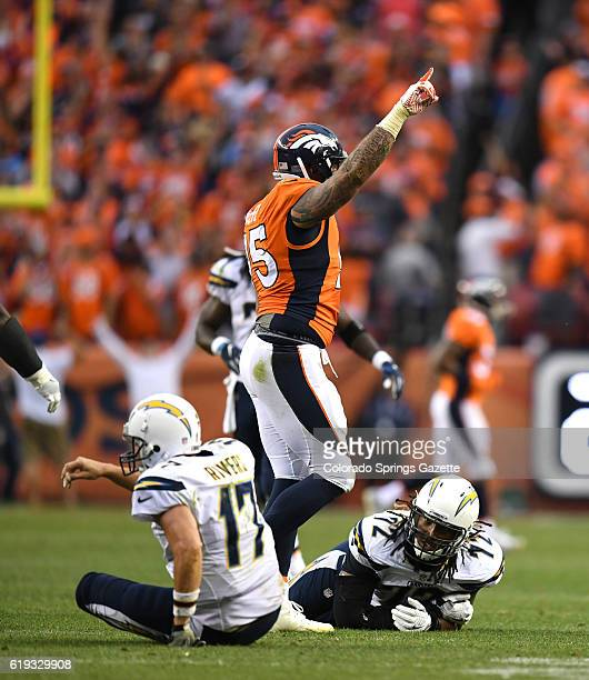 Denver Broncos defensive end Derek Wolfe celebrates after knocking Philip Rivers to the ground and forcing him to throw incomplete in the fourth...