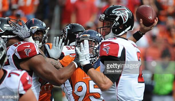 Denver Broncos defensive end Derek Wolfe fights through a a block to get to Atlanta Falcons quarterback Matt Ryan in the first quarter at Sports...