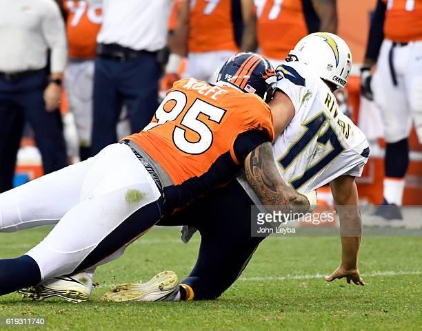 Denver Broncos defensive end Derek Wolfe puts a big hit on San Diego Chargers quarterback Philip Rivers during the 4th quarter October 30 2016 at...