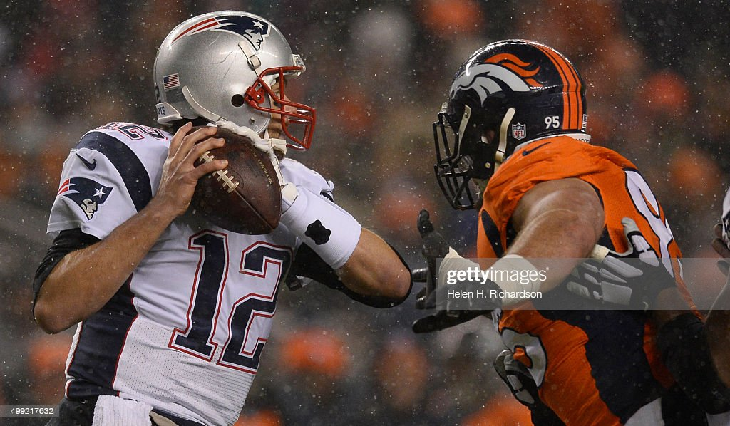 Denver Broncos defensive end <a gi-track='captionPersonalityLinkClicked' href=/galleries/search?phrase=Derek+Wolfe&family=editorial&specificpeople=7193066 ng-click='$event.stopPropagation()'>Derek Wolfe</a> (95) puts pressure on New England Patriots quarterback <a gi-track='captionPersonalityLinkClicked' href=/galleries/search?phrase=Tom+Brady+-+American+Football+Quarterback&family=editorial&specificpeople=201737 ng-click='$event.stopPropagation()'>Tom Brady</a> (12) and grabs him for a sack during the first quarter November 29, 2015 at Sports Authority Field at Mile High Stadium.