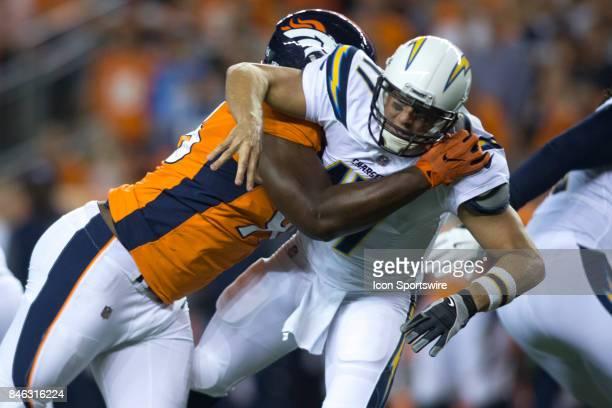 Denver Broncos defensive end Shelby Harris knocks down Los Angeles Chargers quarterback Philip Rivers during the Los Angeles Chargers vs Denver...