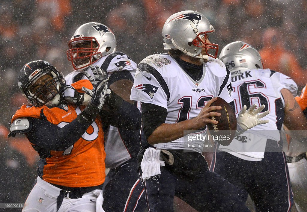 Denver Broncos defensive end <a gi-track='captionPersonalityLinkClicked' href=/galleries/search?phrase=Vance+Walker&family=editorial&specificpeople=4480046 ng-click='$event.stopPropagation()'>Vance Walker</a> (96) gets blocked as he moves in on New England Patriots quarterback <a gi-track='captionPersonalityLinkClicked' href=/galleries/search?phrase=Tom+Brady+-+American+Football+Quarterback&family=editorial&specificpeople=201737 ng-click='$event.stopPropagation()'>Tom Brady</a> (12) during the third quarter November 29, 2015 at Sports Authority Field at Mile High Stadium.