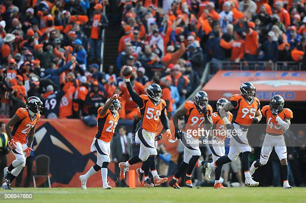 Denver Broncos defensive players from left Aqib Talib Chris Harris Von Miller Malik Jackson Darian Stewart Derek Wolfe and TJ Ward celebrate after an...