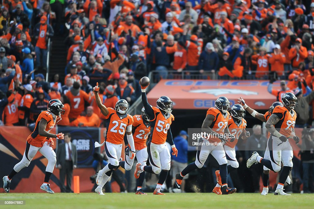 Denver Broncos defensive players from left Aqib Talib Chris Harris Darian Stewart Von Miller Malik Jackson John Bush and Derek Wolfe celebrate after...