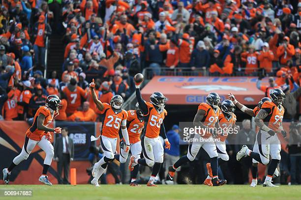 Denver Broncos defensive players from left Aqib Talib Chris Harris Darian Stewart Von Miller Malik Jackson John Bush and Derek Wolfe celebrate after...