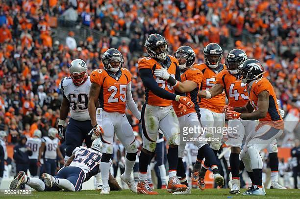 Denver Broncos defensive players from left Chris Harris Von Miller Kayvon Webster Brandon Marshall TJ Ward and Aqib Talib react after a defensive...