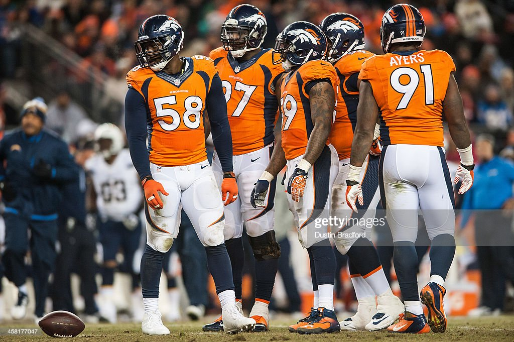 Denver Broncos defensive players from left Von Miller Malik Jackson Danny Trevathan Terrance Knighton and Robert Ayers await the play during a game...