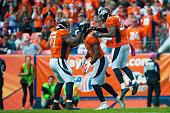 Denver Broncos defensive players Malik Jackson DeMarcus Ware and Darian Stewart celebrate a first quarter Ware sack against the Minnesota Vikings...
