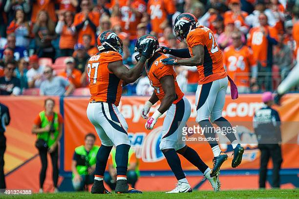 Denver Broncos defensive players Malik Jackson DeMarcus Ware and Darian Stewart celebrate a first quarter Ware sack against the Minnesota Vikings...