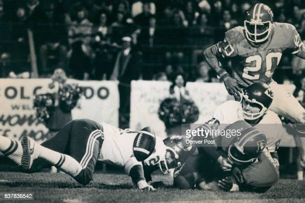 Denver Broncos Denver's Bill Thompson is pinned by Barry Pearson of Kansan City as Bronco Charles Greer Tries to recover a fumble by Thompson of a...