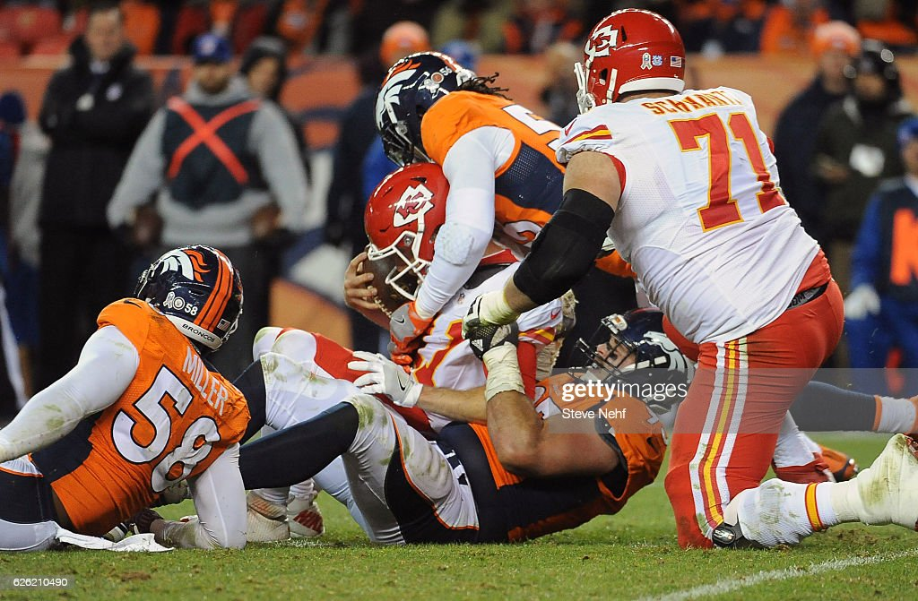 d3d8e757dd9 ... Denver Broncos Derek Wolfe, Von Miller and Shane Ray sack Kansas City  Chiefs quarterback Alex ...