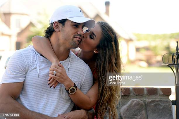 Denver Broncos Eric Decker gets a kiss on the cheek from his wife Jessie James at their home July 17 2013 Profile story on the wide receiver
