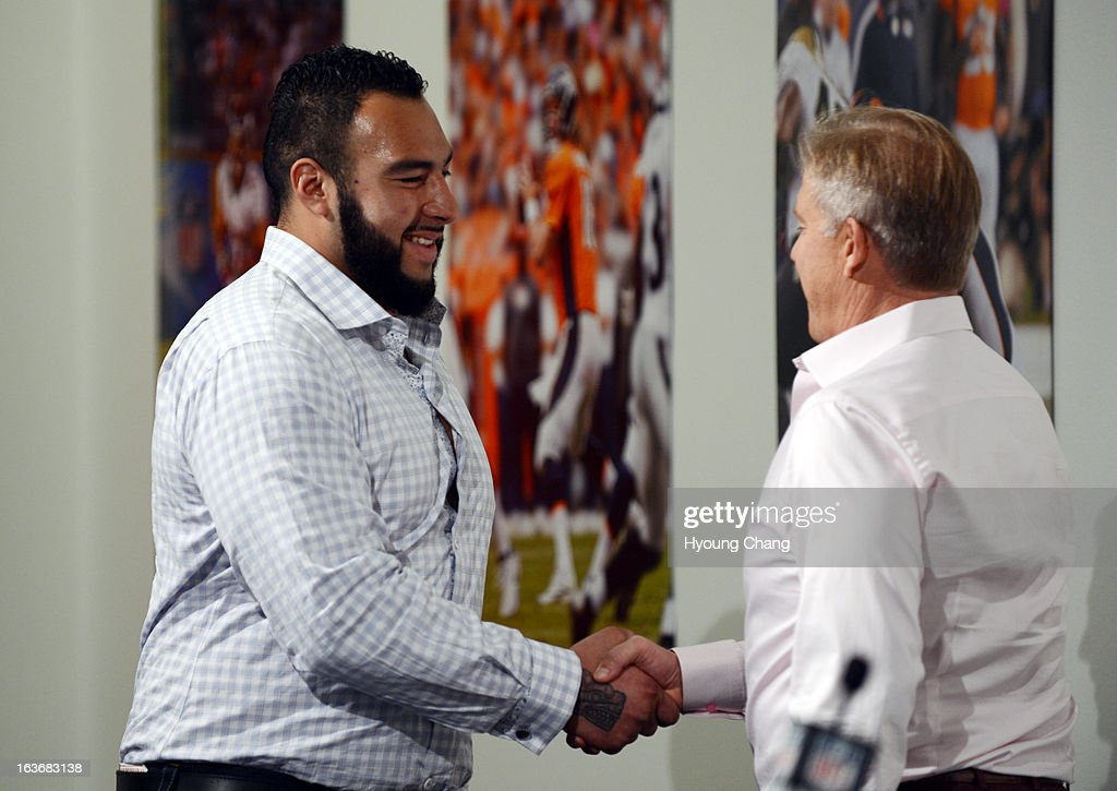 Denver Broncos executive vice president John Elway, right, introduced Louis Vasquez at Dove Valley. March 14, 2013. Denver, Colorado. Vasquez, ex-Chargers guard, agreed to 4-year deal with Broncos.