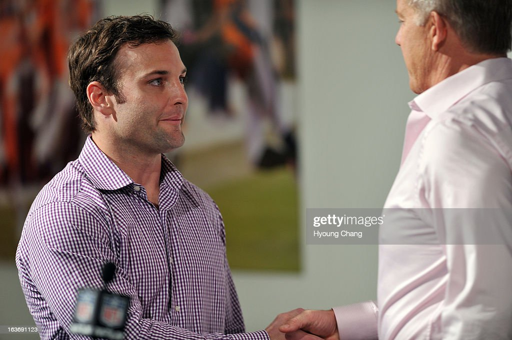 Denver Broncos executive vice president John Elway, right, introduced Wes Welker at Dove Valley. March 14, 2013. Denver, Colorado. Pro Bowl receiver Welker agreed to a two-year, $12 million deal with Broncos.