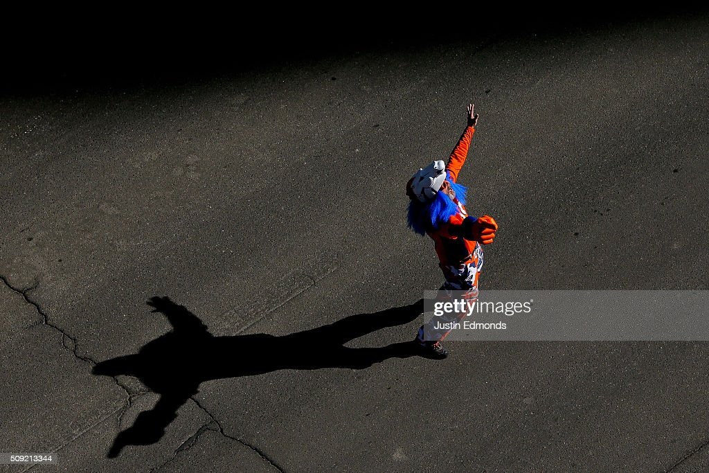 A Denver Broncos fan celebrates in the streets during a victory parade to celebrate their Super Bowl championship on February 9, 2016 in Denver, Colorado. The Broncos defeated the Carolina Panthers 24-10 in Super Bowl 50.