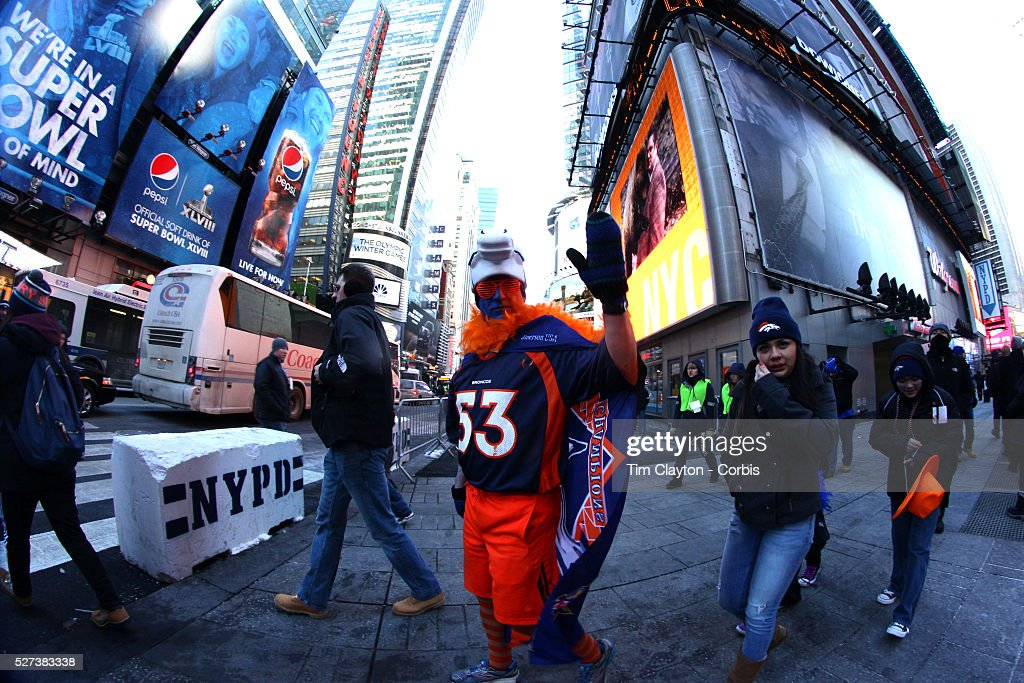 A denver broncos fan dressed in his teams colors during for Activities in times square