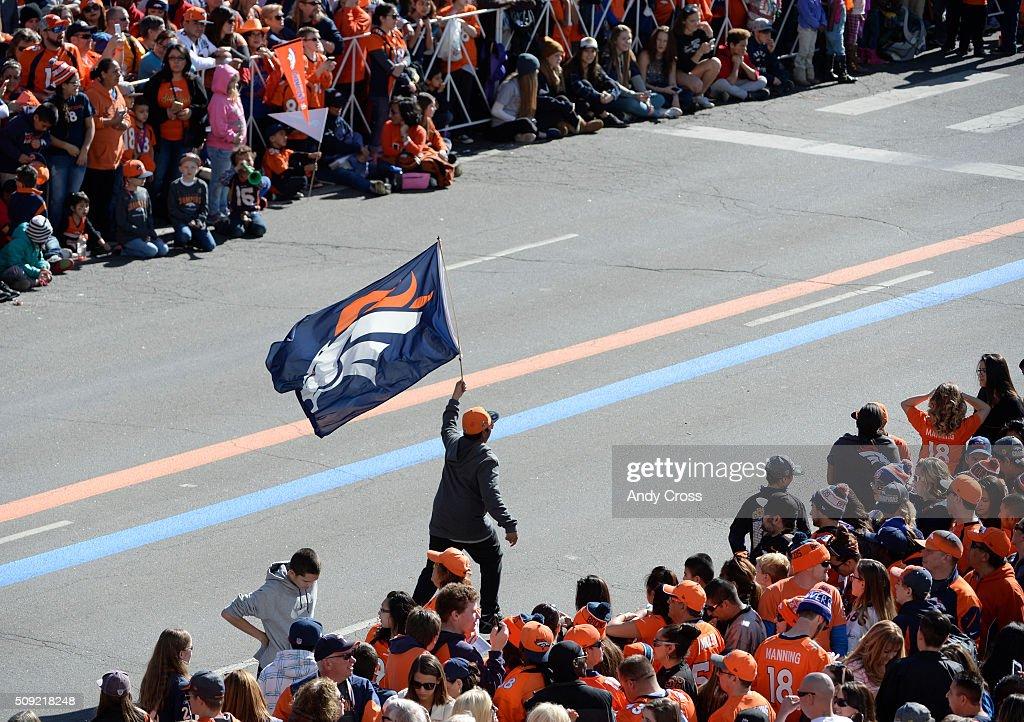 A Denver Broncos fan runs up Broadway before the Denver Broncos Super Bowl 50 celebration parade February 07, 2016.