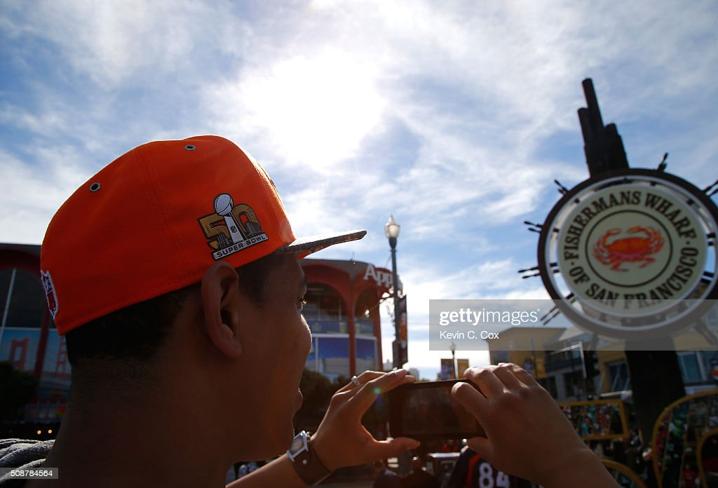 A Denver Broncos fan takes a picture for some friends in front of the Fisherman's Wharf sign on February 6, 2016 in San Francisco, California.