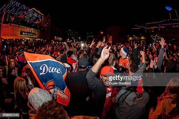 Denver Broncos fans celebrate in the street after the Denver Broncos won Super Bowl 50 on Market Street in Lower Downtown on February 7 2016 in...