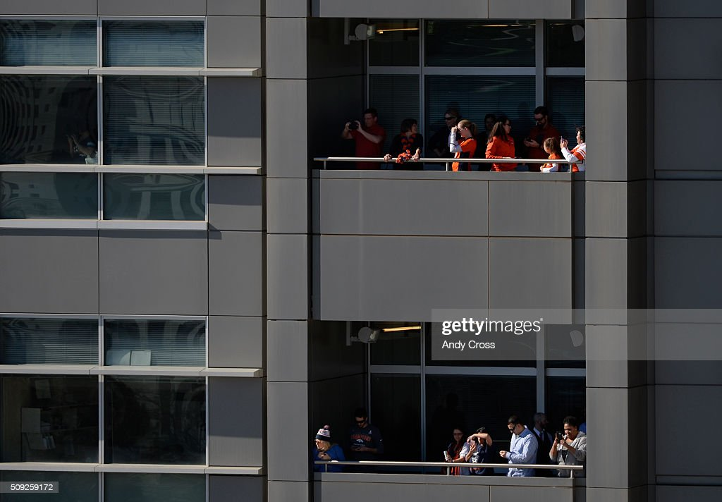 Denver Broncos fans get a birds-eye view of the Denver Broncos Super Bowl 50 celebration from the Webb Building February 07, 2016.