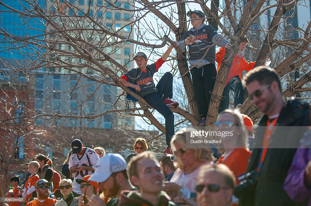 Denver Broncos fans line the street before Broncos players and personnel take part in a victory parade after the Broncos won Super Bowl 50 on 17th Street on February 9, 2016 in Denver, Colorado.