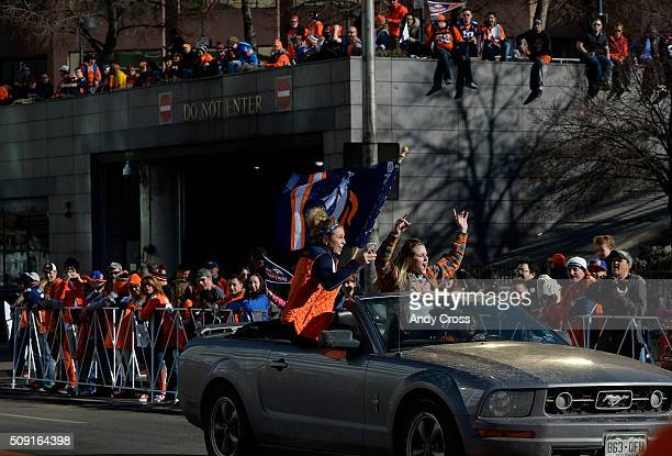 Denver Broncos fans ride down Broadway near Colfax prepping for the Super Bowl 50 celebration parade February 07 2016