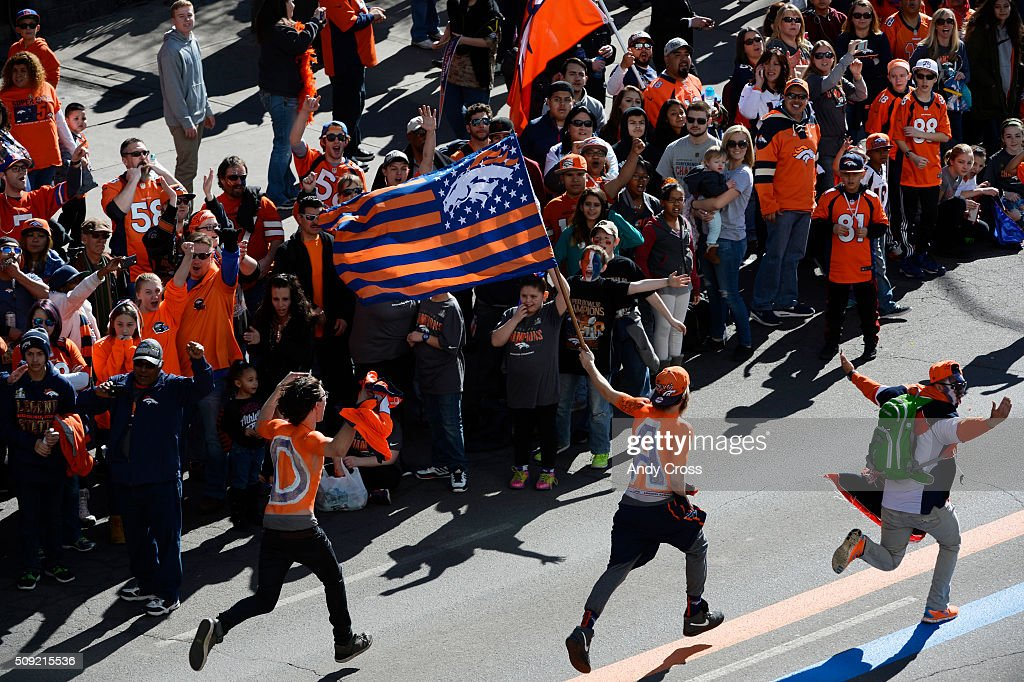 Denver Broncos fans run up Broadway near Colfax just before the Denver Broncos Super Bowl 50 celebration parade February 07, 2016.