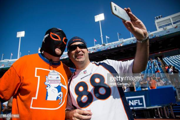 Denver Broncos fans take a selfie photograph before the game between the Buffalo Bills and the Denver Broncos on September 24 2017 at New Era Field...