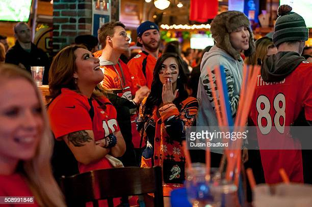 Denver Broncos fans watch Super Bowl 50 at It's Brothers a bar in Lower Downtown on February 7 2016 in Denver Colorado