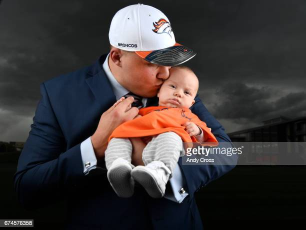 Denver Broncos first round draft pick Garett Bolles gives his 4month old son Kingston a kiss at Dove Valley April 28 2017 in Englewood Colorado