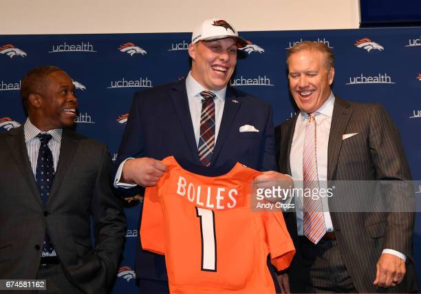 Denver Broncos first round draft pick Garett Bolles poses with head coach Vance Joseph left and general manager/executive vice president of football...