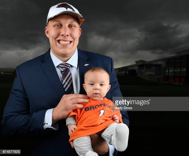 Denver Broncos first round draft pick Garett Bolles with his 4month old son Kingston at Dove Valley April 28 2017 in Englewood Colorado