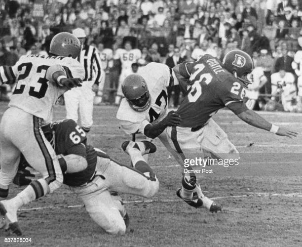 Denver Broncos Frank Quayle who replaced Little in Denver lineup races five yards before being felled by Cincinnati's Charlie King Walt Highsmith...