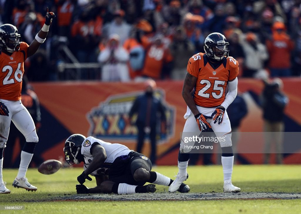 Denver Broncos free safety Rahim Moore (26) and Denver Broncos cornerback Chris Harris (25) celebrate an incomplete pass intended for Baltimore Ravens wide receiver Anquan Boldin (81) during the first quarter. The Denver Broncos vs Baltimore Ravens AFC Divisional playoff game at Sports Authority Field Saturday January 12, 2013.