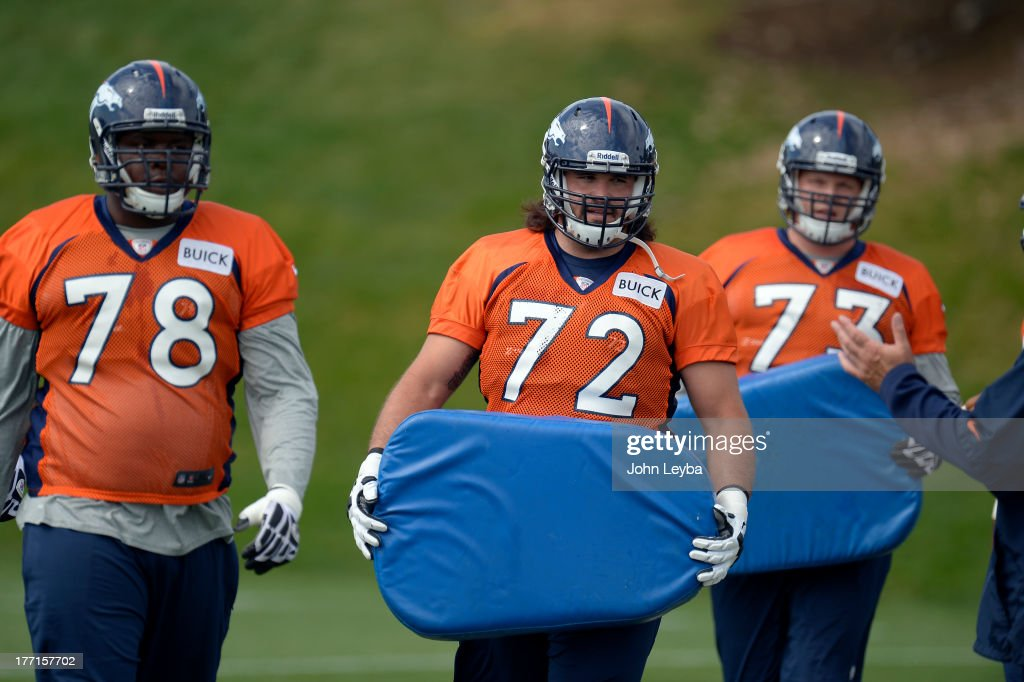 Denver Broncos G John Moffitt works with the offense during practice August 22, 2013 at Dove Valley