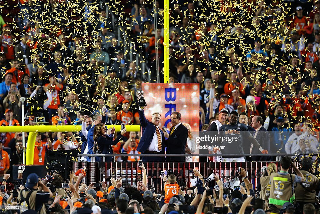 Denver Broncos general manager John Elway holds up the Vince Lombardi Trophy after defeating the Carolina Panthers during Super Bowl 50 at Levi's...