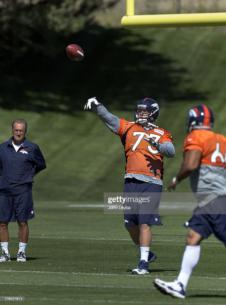 Denver Broncos guard <a gi-track='captionPersonalityLinkClicked' href=/galleries/search?phrase=Chris+Kuper&family=editorial&specificpeople=469695 ng-click='$event.stopPropagation()'>Chris Kuper</a> (73) throws a pass to fellow lineman in drills during practice September 3, 2013 at Dove Valley.