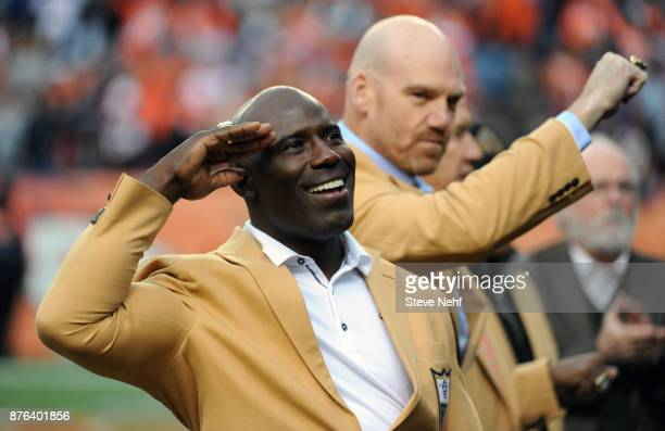 Denver Broncos Hall of Fame members Terrell Davis and Gary Zimmerman salute the fans during the first half of the game against the Cincinnati Bengals...